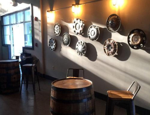 Evolving Painted Hub Cap Wall at Brewery Legitimus